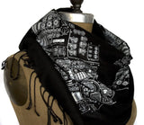 White ink on black pashmina.