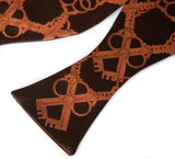 Copper ink on dark brown bow tie