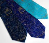 Bermuda Triangle Neckties. Antique brass on french blue, royal blue and turquoise silk