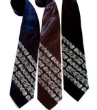 Bike Chain Stripe Neckties. Dove grey on navy, charcoal, black.