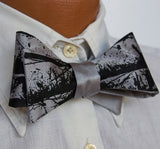 Black ink on silver bow tie.