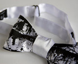 Black ink on white bow tie.