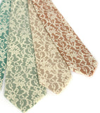 lace print silk neckties. Ivory-cream ink on mint, seafoam, peach, pale copper