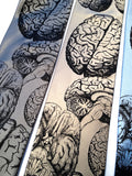 Anatomical brain ties. Black ink on silver, champagne, sky blue.