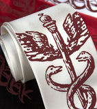 Crimson ink on white, black, red, cream