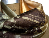Chocolate ink on olive ombre silk scarf.