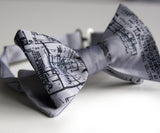 Navy ink on a silver bow tie.