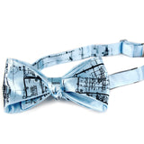 Navy ink on a sky blue bow tie.