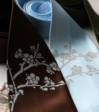 Cherry Blossom Neckties. Silver ink on dark brown, sky blue.