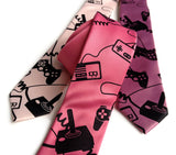 Video Game necktie: black on honeysuckle; black on orchid; black on ballet pink.