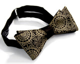 Antique brass ink on a black bow tie.