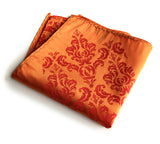 Damask pocket square: dark coral on carrot.
