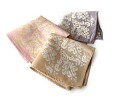 Damask pocket square: white on soft gold; ivory-cream on oyster; ivory-cream on ballet pink.