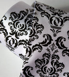 Black ink on white microfiber.