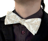 Damask print bow tie, by Cyberoptix. Warm cream ink on cream bow tie.
