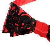Black ink on a red bow tie.