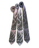 Fern leaf necktie: Black pearl on oyster; aluminum; steel.