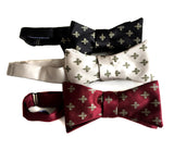 Fleue de Lis bow ties by Cyberoptix. Burgundy; platinum; black.