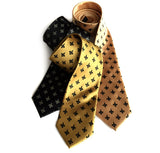 Fleur de lis ties. L to R: black; gold; honey.