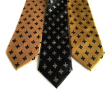 Fleur de lis ties. L to R: Honey; black; gold.