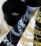Silver ink on black, gold ink on white and black skinny ties.