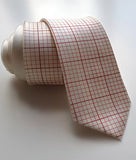 Cyberoptix Graph Paper necktie. Dark salmon print on cream.