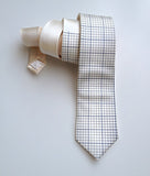 Graph Paper necktie: Steel ink on platinum.