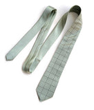 Graph Paper tie: Golden olive ink on seafoam.