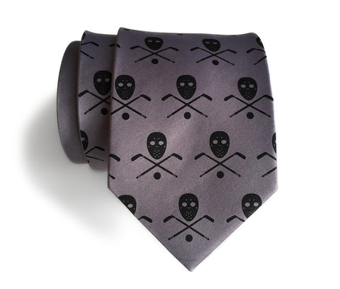 Hockey necktie. Stick, mask & puck print.