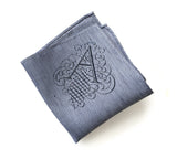 "Initial Pocket square: letter ""A"" in navy variegated light blue linen."