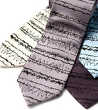 Insomnia Necktie: Black on cream, silver, charcoal, sky blue. Standard microfiber.