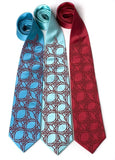 Crimson ink on turquoise, aqua, crimson. Standard width silk.