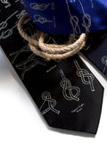 Ivory-cream ink on black, navy, royal blue silk.