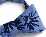 Blue-violet ink on a blue aster bow tie.