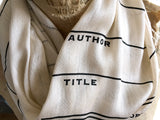 date due slip library scarf, black on parchment.