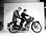 Charles and Ray Eames pose on a Velocette motorcycle, 1948. ©Eames Office, LLC