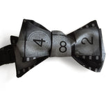 black movie film leader bow tie