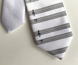 boys clip-on music paper tie. black on whie