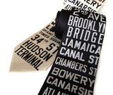 New York City Subway Sign Necktie. Ivory-cream on black; black on cream.