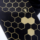 Gold and black Beehive necktie.