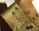 Honey Bee Necktie: Chocolate on gold.