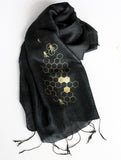 Gold ink on black silk scarf.