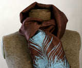 Electric blue ink on chocolate silk scarf.