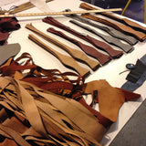 Perforated Automotive Leather Bow Ties in process.