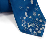Blue Pill necktie. Dove gray print on french blue.