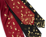 Pill Spill ties: Gold print on burgundy and black microfiber.