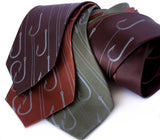 Fish Hook neckties. Dove gray on dark brown, cinnamon, olive.
