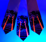 Raving Laser Kitten Neckties under blacklight. Black and glow red on light pink, white, pink.