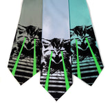 Laser Cat ties. Black and glow green on seafoam, sky blue, aqua.