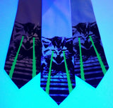 Raving Laser Kittne Ties under blacklight: glow green on seafoam, sky blue, aqua.